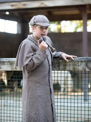 12 year old Jacob VanDenBoom, of Linwood, Mi, shows off his Sherlock Holmes costume at the Zoo Boo event.