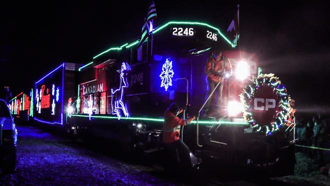 """Beautifully decorated railroad cars light up the night as the Canadian Pacific Holiday Train rolls into Oconomowoc  in 2017; the train also stopped in Hartland. This year, the two communities have set up a friendly """"food fight"""" to see which one can donate the most to local food pantries."""