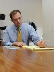 Chillicothe Mayor Luke Feeney takes notes as he talks