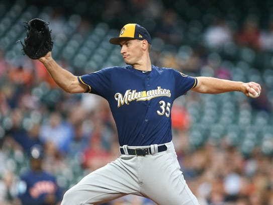 Brent Suter delivers a pitch for the Brewers during