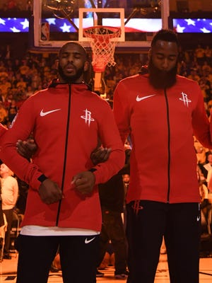 The Houston Rockets stand on the court during introductions before Game 4 of the Western Conference finals.