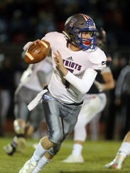 Page quarterback Cade Walker looks for an open receiver