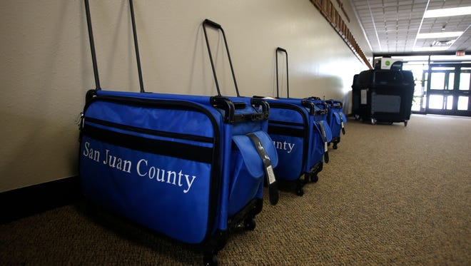 Election supply bags sit in a hallway on Monday ahead of Tuesday's primary elections at the San Juan County Clerk's Office in Aztec.