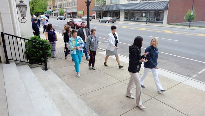 A group walks during the Move More Challenge community kick-off Wednesday down Main Street. The Move More Challenge participants will track their extra minutes of activity every week in a log to help encourage better health habits.