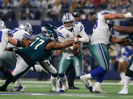 Dec 9, 2018; Arlington, TX, USA; Philadelphia Eagles defensive end Michael Bennett (77) causes a fumble by Dallas Cowboys quarterback Dak Prescott (4) in the third quarter at AT&T Stadium. Mandatory Credit: Tim Heitman-USA TODAY Sports