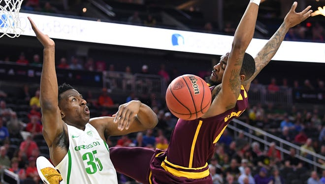 Oregon Ducks forward Kavell Bigby-Williams (35) blocks a shot attempt by Arizona State Sun Devils guard Torian Graham (4) during the Pac-12 Conference Tournament at T-Mobile Arena.