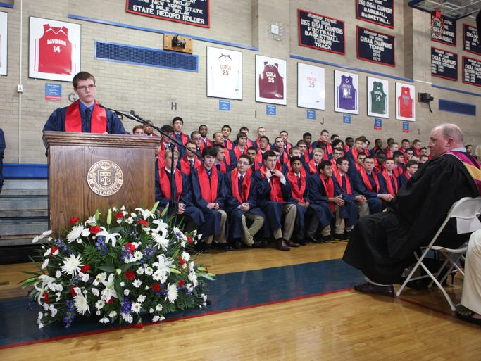 Matthew Eberhart delivers the salutatorian address at the Archbishop Stepinac High School graduation, May 22, 2014 at the high school in White Plains.