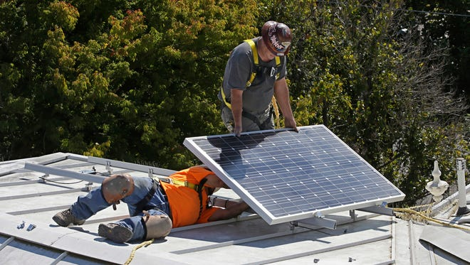 In this Oct. 16, 2015, file photo a solar panel is installed on the roof of the Old Governor's Mansion State Historic Park in Sacramento.