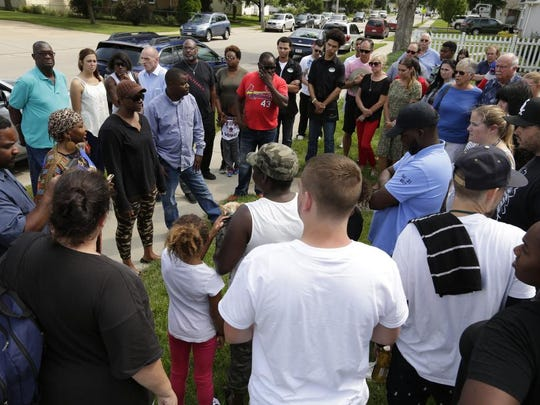 Family, friends, neighbors and community members held