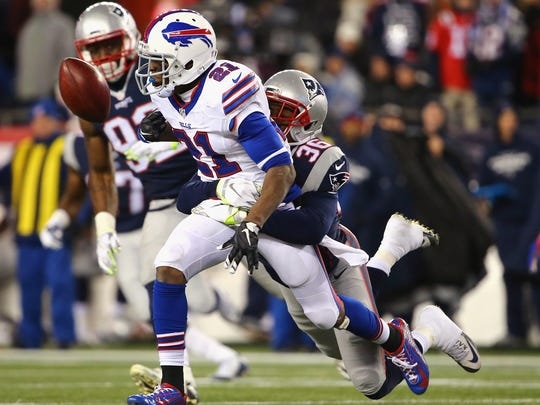FOXBORO, MA - NOVEMBER 23:  Brandon King #36 of the New England Patriots forces a fumble from Leodis McKelvin #21 of the Buffalo Bills during the fourth quarter at Gillette Stadium on November 23, 2015 in Foxboro, Massachusetts.  (Photo by Maddie Meyer/Getty Images)