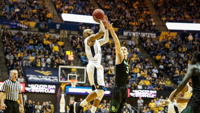 West Virginia Mountaineers guard Jevon Carter (2) shoots a three-pointer late in the second half against the Baylor Bears at WVU Coliseum.