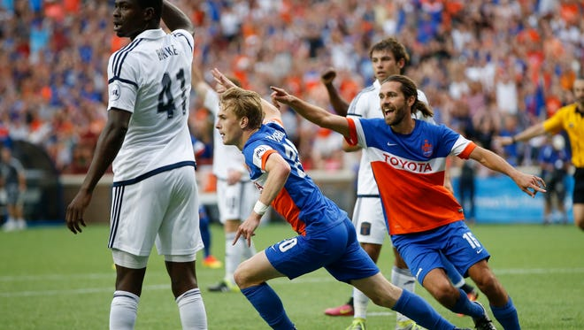 FC Cincinnati midfielder Jimmy McLaughlin (20), center, celebrates his goal with FC Cincinnati defender Pat McMahon (15), right, as Bethlehem's Cory Burke looks to the linesman for an offside call in the second half during the USL soccer match between Bethlehem Steel FC and FC Cincinnati, Saturday, July 2, 2016, at Nippert Stadium in Cincinnati.