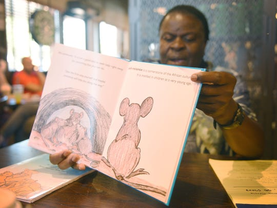 """Henry Kayongo-Male says each story has a life lesson to be learned. His book """"The Rat Family"""" is about being self reliant in life."""