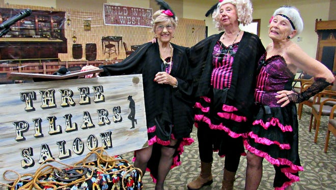 Chorus girls Dusty, Betty Sue, and Dolly, played by residents Janet Zganjar, Suzanne Diesness, and Barbara Lee, strike a pose on set.