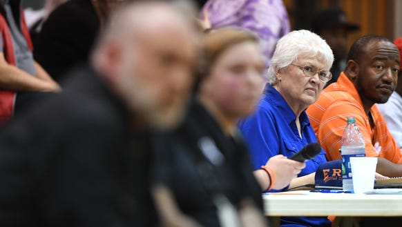 Martha Lindsey, mother of Berea girls basketball coach Matt Lindsey, keeps the scorebook as the Bulldogs play Chester during the first round of the Class AAA playoffs Monday at Berea High School.