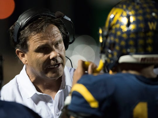 Naples head coach Bill Kramer talks with quarterback Jordan Persad-Tirone during the game against Lehigh at Naples High Friday night, Nov. 11, 2016.