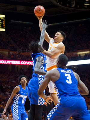 Tennessee's Grant Williams shoots over Kentucky's Edrice Adebayo on Tuesday at Thompson-Boling Arena.