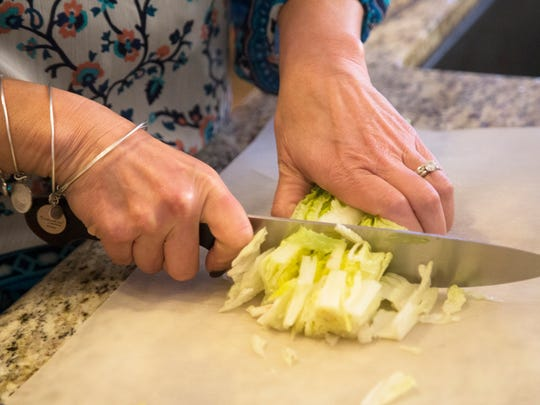 Jenny Beutner chops hearts of romaine —from a package