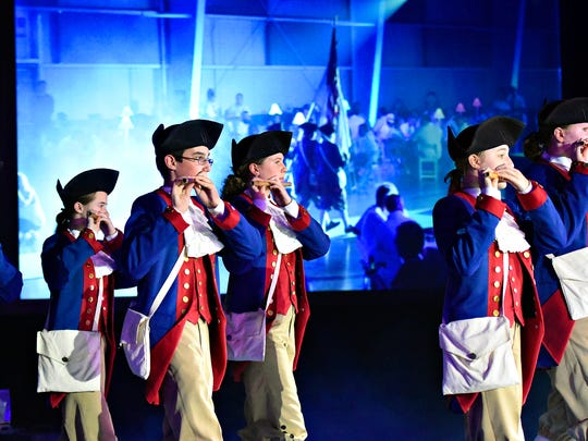 The Central York High School Fife & Drum Corps leads the Voith family into the 150th anniversary celebration in Memorial Hall at the York Expo Center, Friday, June 9, 2017. Dawn J. Sagert photo