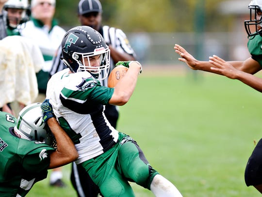 A Fairfield player struggles for extra yardage in a game against York Tech in 2017. The next year, the Green Knights nearly didn't have enough players to field a varsity team.