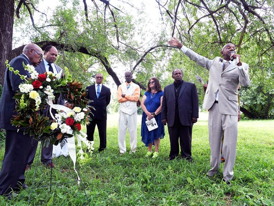 Pastor Enoch Fuzz, right, of Corinthian Missionary Baptist Church delivers a funeral sermon honoring the African Americans who died at Dutchman's Curve in Nashville 100 years ago . The service was held under a tree Mount Ararat Cemetery Nashville, Tenn on Sunday, July 8, 2018