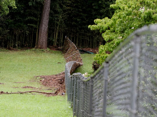 A backyard fence was pushed down by the force of the rising waters Thursday evening along Blackwater Creek on Old Forest Drive on Friday, August 3, 2018 in Lynchburg.