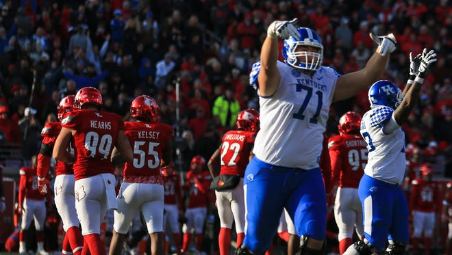 Kentucky's Logan Stenberg gestured with the Ls down towards the crowd after the Wildcats kicked a field goal to take the lead with 12 seconds remaining. The Wildcats stunned the Cards 41-38 to take the Governor's Cup.