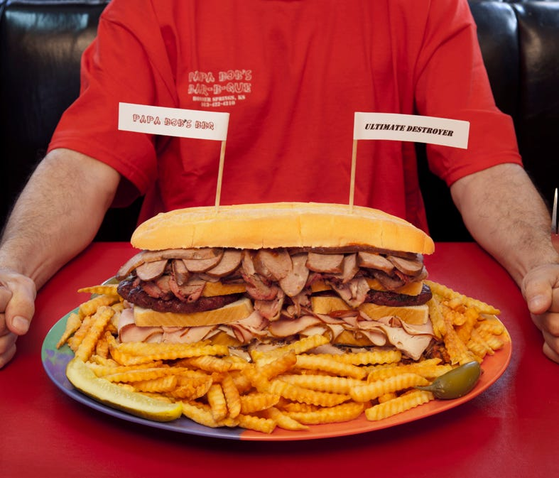 Papa Bob's Bar-B-Que in Bonner Springs, Kan., serves the Ultimate Destroyer, a foot-long hoagie bun with mounds of pulled pork, turkey breast, smoked ham, hamburger, brisket and sausage. All accompanied by a half-pound of fries.
