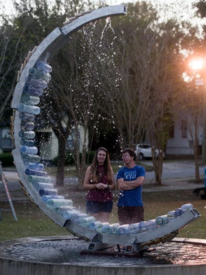 Jane Hatcher, left, talks Monday, Nov. 6, 2017, with artist Devon Murphy about his art installation in the park across from the First City Arts Center in Pensacola.