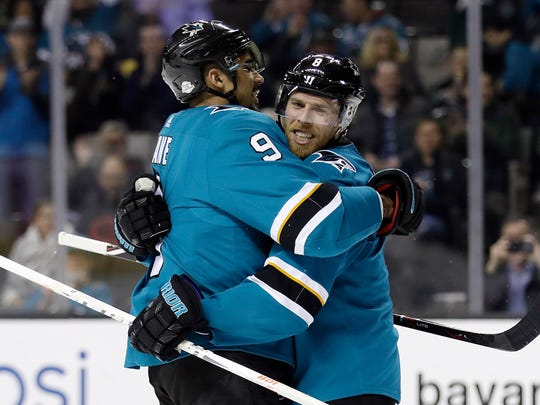 San Jose Sharks' Joe Pavelski, right, celebrates his goal with teammate Evander Kane during the second period of an NHL hockey game against the Edmonton Oilers on Tuesday, Feb. 27, 2018, in San Jose, Calif. (AP Photo/Marcio Jose Sanchez)