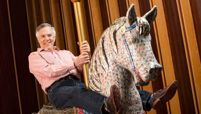 Acuity Insurance CEO Ben Salzmann sits atop a carousel horse in the middle of the company's headquarters in Sheboygan. The whimsical executive defies industry norms but produces best-in-class results.