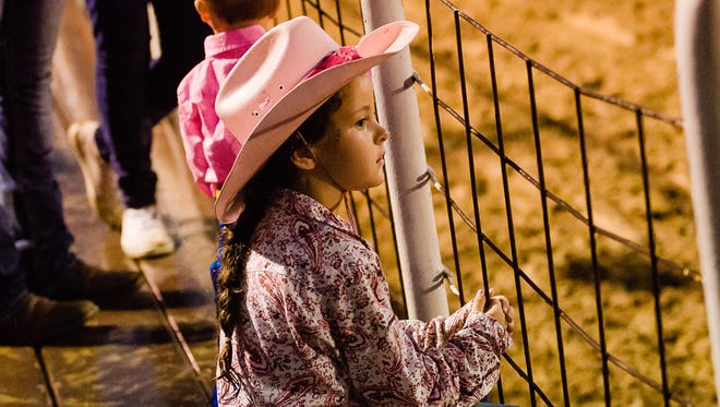 A young cowgirl enjoys the 2016 Pink for Peitz Rodeo