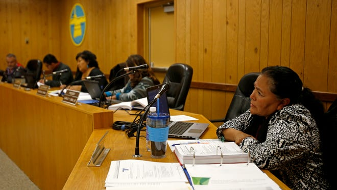 Members of the Central Consolidated School District board and interim Superintendent Colleen Bowman, at right, listen on Thursday during a work session at the district's board room in Shiprock.