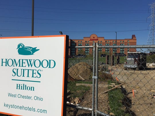 The 112-room Hilton Homewood Suites next to the booming