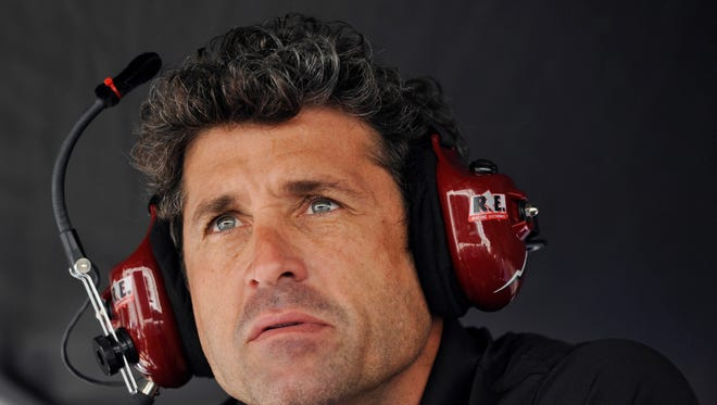 Patrick Dempsey looks on from the pit area during qualifying for the American Le Mans Series' Petit Le Mans auto race at Road Atlanta in Braselton, Ga. Dempsey's love affair with sports-car racing was always more than a frivolous dalliance.