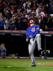 Chicago Cubs' Anthony Rizzo reacts after scoring on a hit by Miguel Montero during the 10th inning of Game 7 of the Major League Baseball World Series against the Cleveland Indians Wednesday, Nov. 2, 2016, in Cleveland. (AP Photo/David J. Phillip)