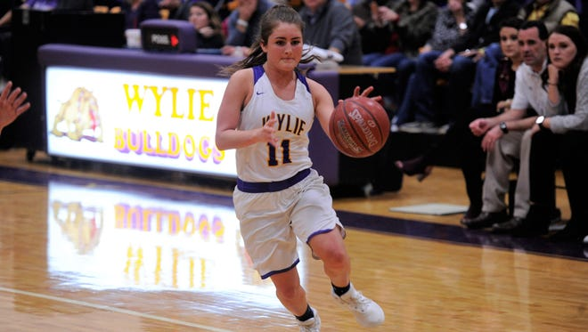 Wylie's Madi Latham drives into the lane during the 72-42 win against Big Spring on Friday, Jan. 26, 2018.