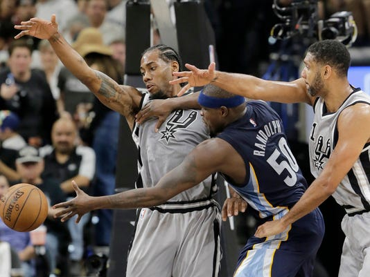 Memphis Grizzlies forward Zach Randolph (50) is pressured by San Antonio Spurs forward Kawhi Leonard, left, and forward Tim Duncan, right, during the second half in Game 1 of a first-round NBA basketball playoff series, Sunday, April 17, 2016, in San Antonio. San Antonio won 106-74. (AP Photo/Eric Gay)