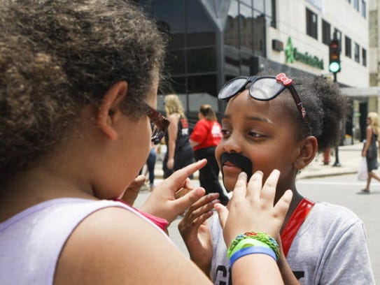 Fake mustaches get kids in the spirit at Bastille Days!