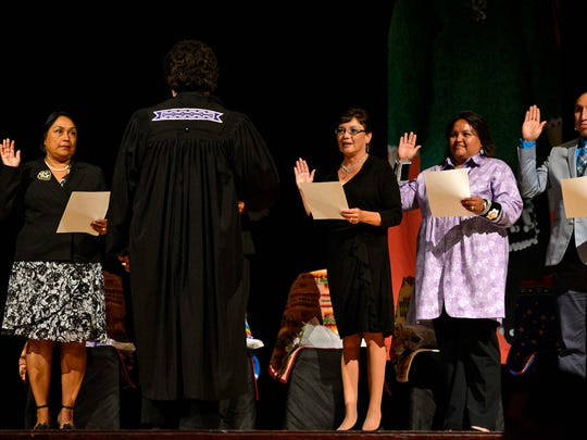 From left, Tina Danforth, Melinda Danforth (not shown), Lisa Summers, Trish King and Brandon Stevens take oaths of office during the Oneida Nation's inauguration ceremony at the Radisson Hotel and Conference Center in Ashwaubenon on Thursday, Aug. 14, 2014.
