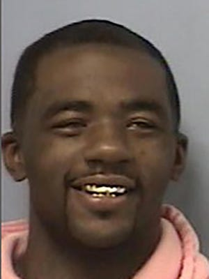 This undated photo provided by the Crittenden County, Arkansas, jail shows Demarcus Donnell Parker. Parker has been sentenced to two life in prison terms plus 835 years for the fatal shooting of an off-duty police officer. Court documents show Parker was convicted Tuesday, SEPT. 8, 2020, by a Crittenden County jury of first-degree murder, illegally shooting a weapon from a vehicle and 21 related charges in the April 2018 shooting death of off-duty Forrest City officer Oliver Johnson.