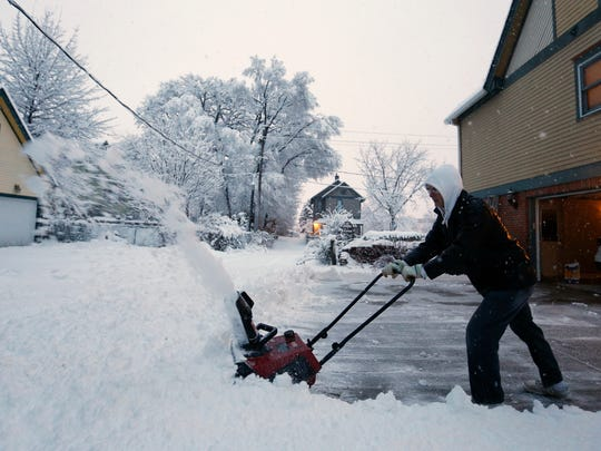 Alan Kessler clears out his driveway Feb. 1 in Des Moines. The storm that weekend was unusual for how widespread it was.