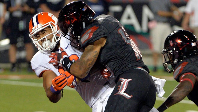 Sep 17, 2015; Louisville, KY, USA; Clemson Tigers tight end Jordan Leggett (16) scores a touchdown while being tackled by Louisville Cardinals cornerback Jaire Alexander (10) during the second half at Papa John's Cardinal Stadium. Clemson defeated Louisville 20-17.  Mandatory Credit: Jamie Rhodes-USA TODAY Sports