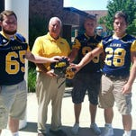South Lyon coach Mark Thomas will rely on holdovers (from left) Brennen McMann, Jeff Gill and Trevor Tank.
