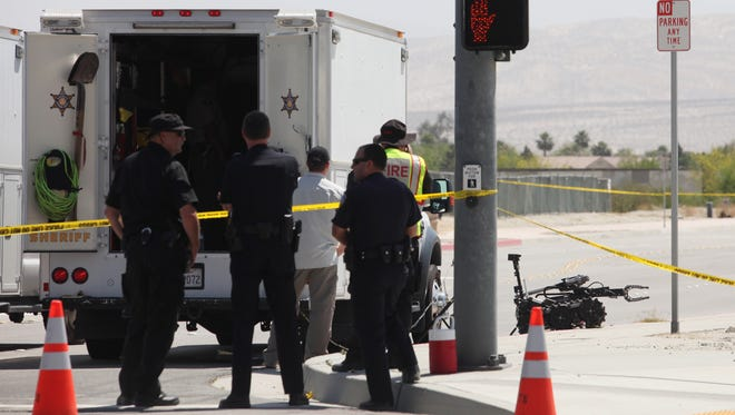 Palm Springs Police respond after the discovery of pipe bombs near Indian Canyon Drive and San Rafael Road on May 7, 2012. The department will now provide the identities of officers involved in shootings after the police union dropped its lawsuit challenging the move.