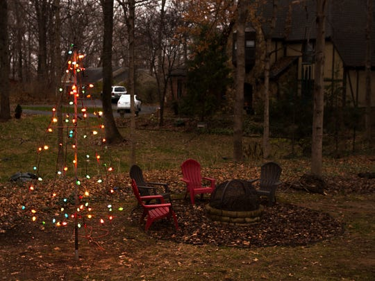 Cinda King's historic metal Christmas tree that was part of her father's business for many years in Evansville. She has been reunited with the tree and it sits, lit, in her yard in Louisville, Ky. Dec. 13, 2016.