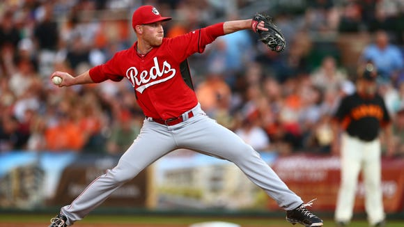 Reds pitcher Anthony DeSclafani throws against the