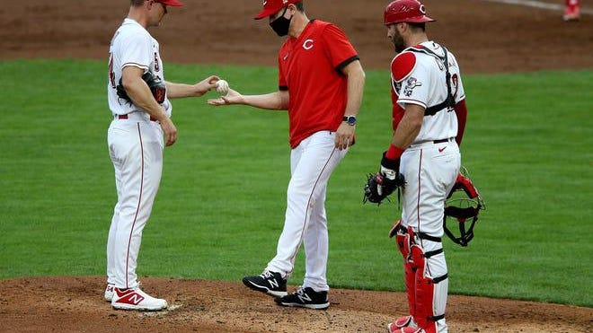 Cincinnati Reds manager David Bell pulls starting pitcher Sonny Gray (54) in the first inning of a Major League Baseball game against the St. Louis Cardinals, Tuesday night, Sept. 1, 2020, at Great American Ball Park in Cincinnati.