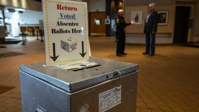 A box for people to return absentee ballots sits in Livonia City Hall in Livonia on Tuesday, March 10, 2020.