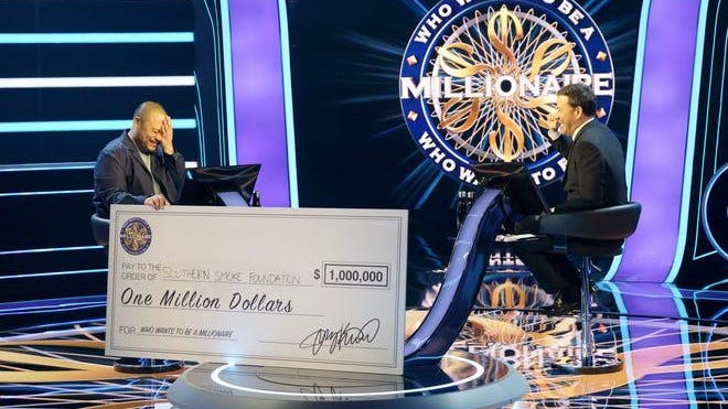 "David Chang reacts after winning $1 million for Texas-based nonprofit Southern Smoke Foundation on ""Who Wants to Be a Millionaire."""